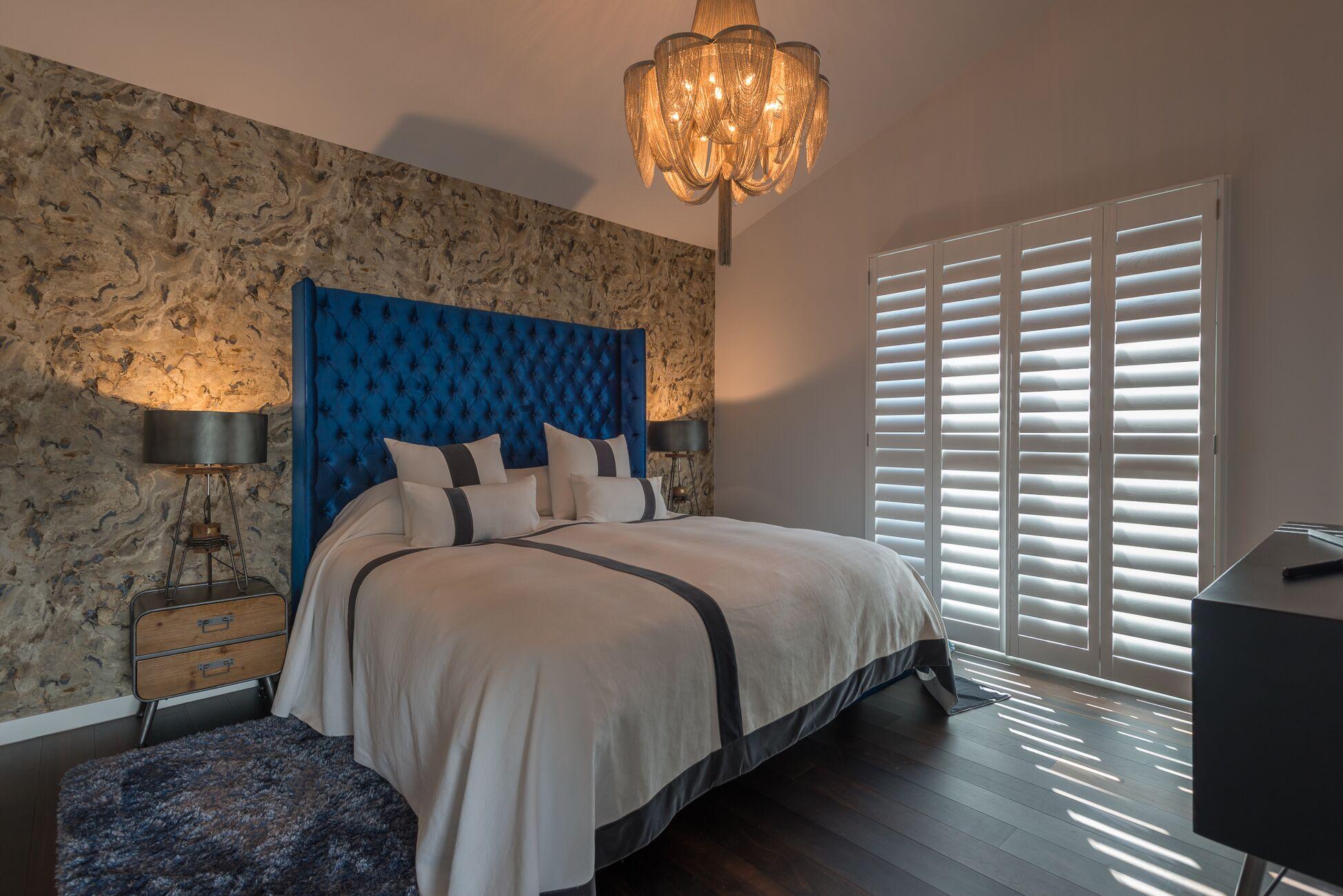 Interior window shutters in the bedroom