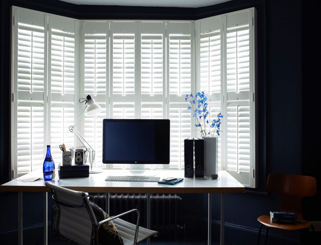 Bay window shutters in a Tier on Tier Design Pure white