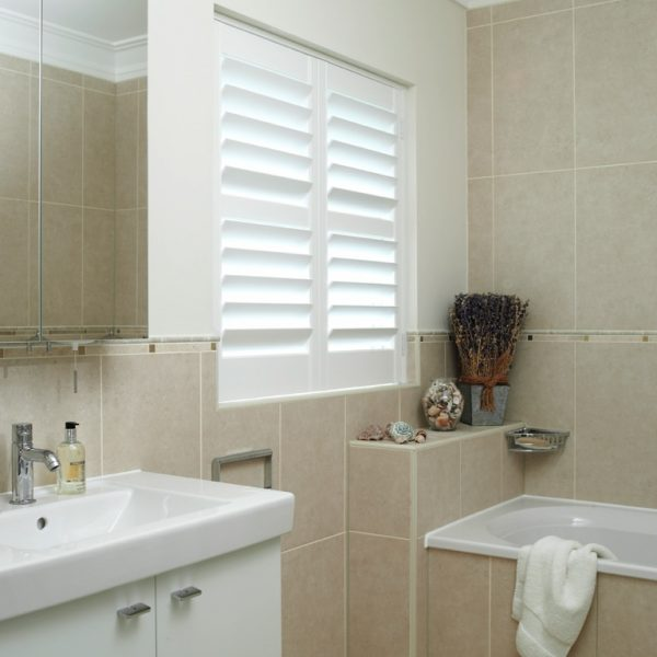 Full-height shutters in the bathroom