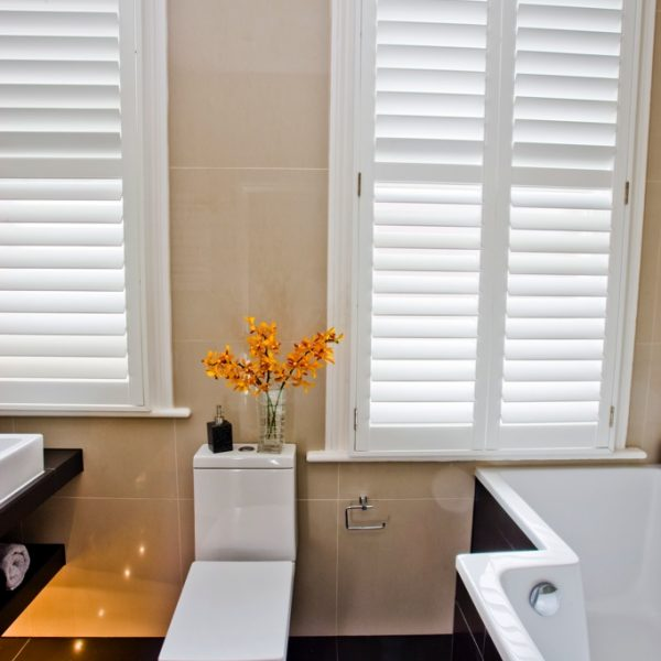 Waterproof Shutters for the Bathroom in Full Height Style design with a white painted finish